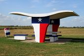 picture of texas flag  - A picnic table at a rest stop in Texas. ** Note: Slight graininess, best at smaller sizes - JPG