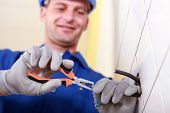 stock photo of electrician  - Electrician at work - JPG