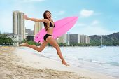 Surfing summer fun woman jumping of joy on beach with surfboard. Surf vacation lifestyle. Asian girl poster