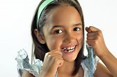 foto of tooth gap  - Young girl flosses her teeth in the morning - JPG