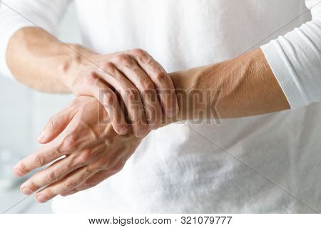 poster of Closeup Of Male Arms Holding Her Painful Wrist Caused By Prolonged Work On The Computer, Laptop. Car