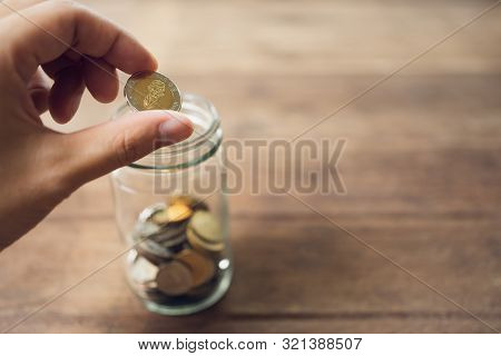 poster of Business Men Put The Coin In A Glass Jar To Save Money, Save Money On Investments, Spend Money When