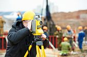 image of theodolite  - One surveyor worker working with theodolite transit equipment at construction site outdoors - JPG