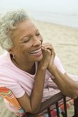 stock photo of early 60s  - Woman Smiling at Beach - JPG