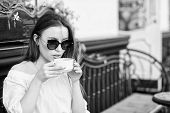 Girl Enjoy Morning Coffee. Woman In Sunglasses Drink Coffee Outdoors. Girl Relax In Cafe Cappuccino  poster