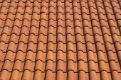 Roof top view. Red tile. The pattern of roof tile. Orange tile roof, abstract background. Roofing te poster