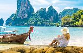 Beautiful Woman On Paradise Ao Nang Krabi Thailand Beach With Llongtail Boat. Adventure, Travel, Rel poster