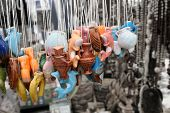 picture of nick-nack  - an image of trinkets hanging in a market stall - JPG