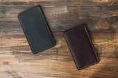 Leather Luxury Phone Cases On A Wooden Background. Beautiful Genuine Leather Phone Cases. poster