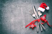 Christmas dinner table place setting with Santas hat poster