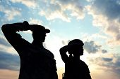 Soldiers In Uniform Saluting Outdoors. Military Service poster