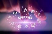 Finger touching tablet with drawn social media icons and LIFESTYLE inscription, social networking co poster