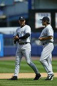 NEW YORK - MAY 20: Derek Jeter #2 and Johnny Damon #18 of the New York Yankees walk together on the