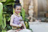 Beautyful Thai Girl Wearing Thai Traditional Clothing poster