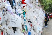 Many Wishes On The Wishing Wall At The House Of The Virgin Mary In Turkey. poster