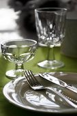 stock photo of banquette  - An afternoon table set for dinner in green - JPG