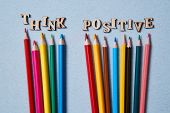 Positive Thinking, Happy And Optimistic Attitude Concept. Colored Pencils And The Words Think Positi poster