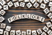 Folklore - Word From Wooden Blocks With Letters, Literary Genres Concept, Random Letters Around, Top poster