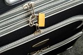 Zippers Locked With A Padlock On A Black Travel Suitcase. Protect The Baggage From Theft During The  poster