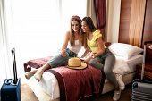 Two Sexy Travelers In Hotel Room poster