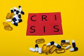 Illegal Drug Crisis Concept Showing Pills And The Message Crisis On A Yellow Background poster