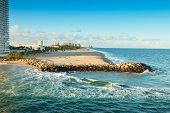 image of inlet  - The inlet to the Atlantic Ocean for cruise ships creates a beach end for local residents to wave and view the cruise ships - JPG