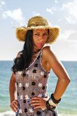image of braless  - View of a beautiful woman in transparent dress in the beach bathed by the sunny rays of Summer - JPG