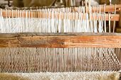 stock photo of thread-making  - Old weaving loom made from timber making cloth in La Purisima mission California - JPG