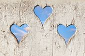 stock photo of outhouse  - Heart shape look out on wooden door to outhouse - JPG