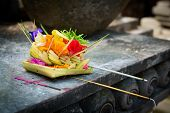 stock photo of aromatic  - Traditional balinese offerings to gods in Bali with flowers and aromatic sticks - JPG