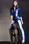 image of friendship belt  - Beautiful woman in denim clothes  standing next to a dog - JPG