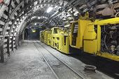 picture of earth-mover  - Yellow coal mine transporter in underground tunnel - JPG