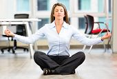 stock photo of interrupter  - Business woman doing yoga at the office - JPG
