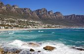 image of 12 apostles  - Camps Bay Beach in Cape Town, South Africa, with the Twelve Apostles in the back ground.