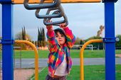 Cute Little Girl On The Monkey Bars For The First Time poster