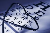 stock photo of snellen chart  - Glasses and eye test chart differential focus blue tone - JPG