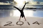 stock photo of sunrise  - happy new year 2014 on the beach with sunrise - JPG