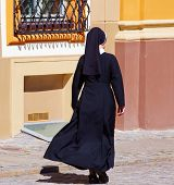 foto of nun  - Christian nuns walking down the street - JPG