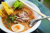 stock photo of gai  - Pork noodle tom yum condensed water egg - JPG
