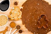 stock photo of gingerbread man  - Traditional Christmas gingerbread cookies dough and spices with happy Gingerbread man and cookie cutter - JPG