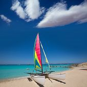 Catamaran sailboat in Illetes beach of Formentera at Balearic Islands