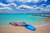 Formentera ibiza ses Illetes beach with windsurf on shore sand