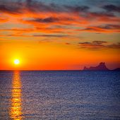 Ibiza sunset Es Vedra view from Formentera la Savina red orange sky