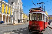 LISBON, PORTUGAL - MARCH 17: Old tram in the Praca do Comercio on March 17, 2014 in Lisbon, Portugal