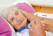 stock photo of caress  - Daughter caress on the cheek her elderly mother - JPG
