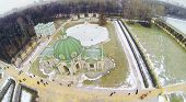 People walk near grot in museum-estate Kuskovo at winter, Moscow, Russia. Aerial view