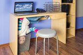 image of inverted  - Little girl in jeans under the table with head in basket at inverted house - JPG