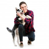 stock photo of husky  - Happy women with her puppy Husky in the studio - JPG