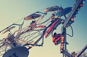 stock photo of carnival ride  - Classic carnival ride in subtle vintage retro tones - JPG