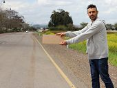 picture of bums  - Bum stand on the side of the road wating for a car to hitchhike him - JPG